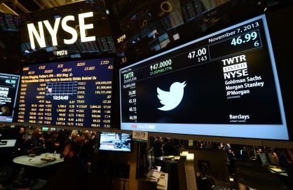 A screen displays a Twitter and share price logo as it starts trading at the New York Stock Exchange (NYSE) on November 7, 2013 in New York. Twitter hit Wall Street with a bang on Thursday, as an investor frenzy quickly sent shares surging after the public share offering for the fast-growing social network. In the first exchanges, Twitter vaulted 80.7 percent to $47, a day after the initial public offering (IPO) at $26 per share. While some analysts cautioned about the fast-changing nature of social media, the debut led to a stampede for Twitter shares. AFP PHOTO/EMMANUEL DUNANDEMMANUEL DUNAND/AFP/Getty Images ORG XMIT: 187363780